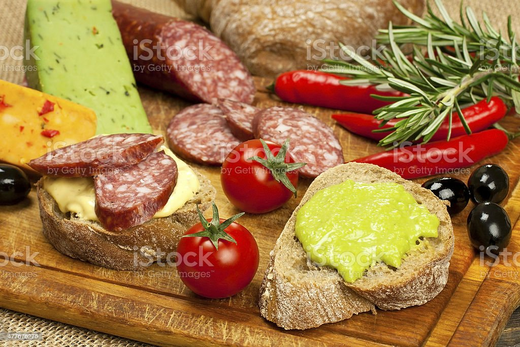 Bread with smoked salami and  cheese cream royalty-free stock photo