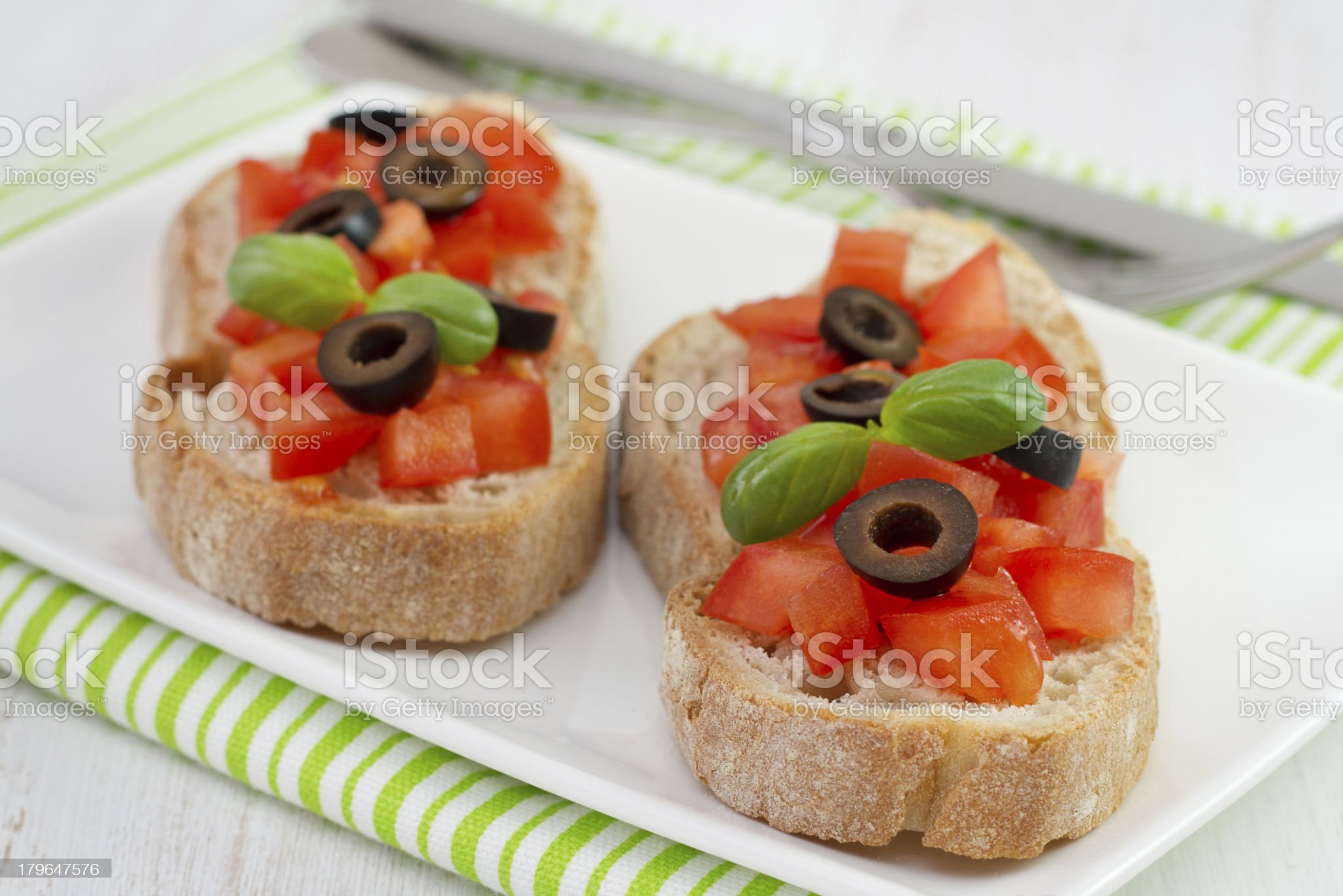 bread with tomato, olives and basil royalty-free stock photo