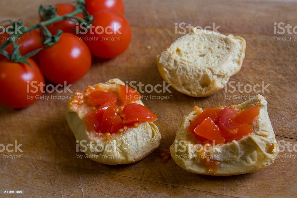 Bread with tomatoes on chopping board. Frise, friselle. stock photo