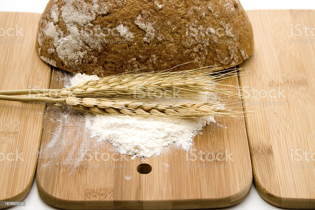 Bread with wheat and flour on edge board stock photo