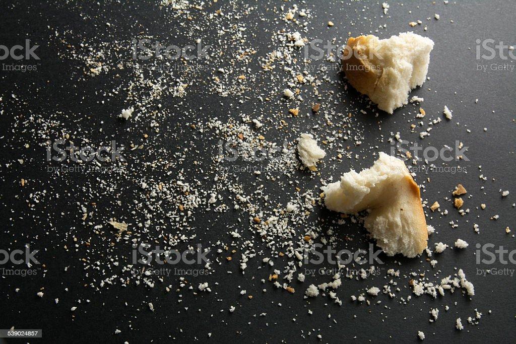 breadcrumbs on black background stock photo