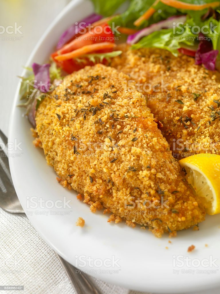Breaded and Baked Fish Fillets with side Salad stock photo