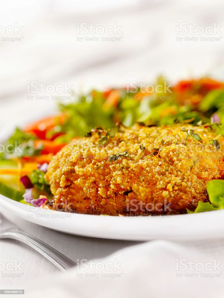 Breaded and Baked Pork Cutlets with a side Salad stock photo