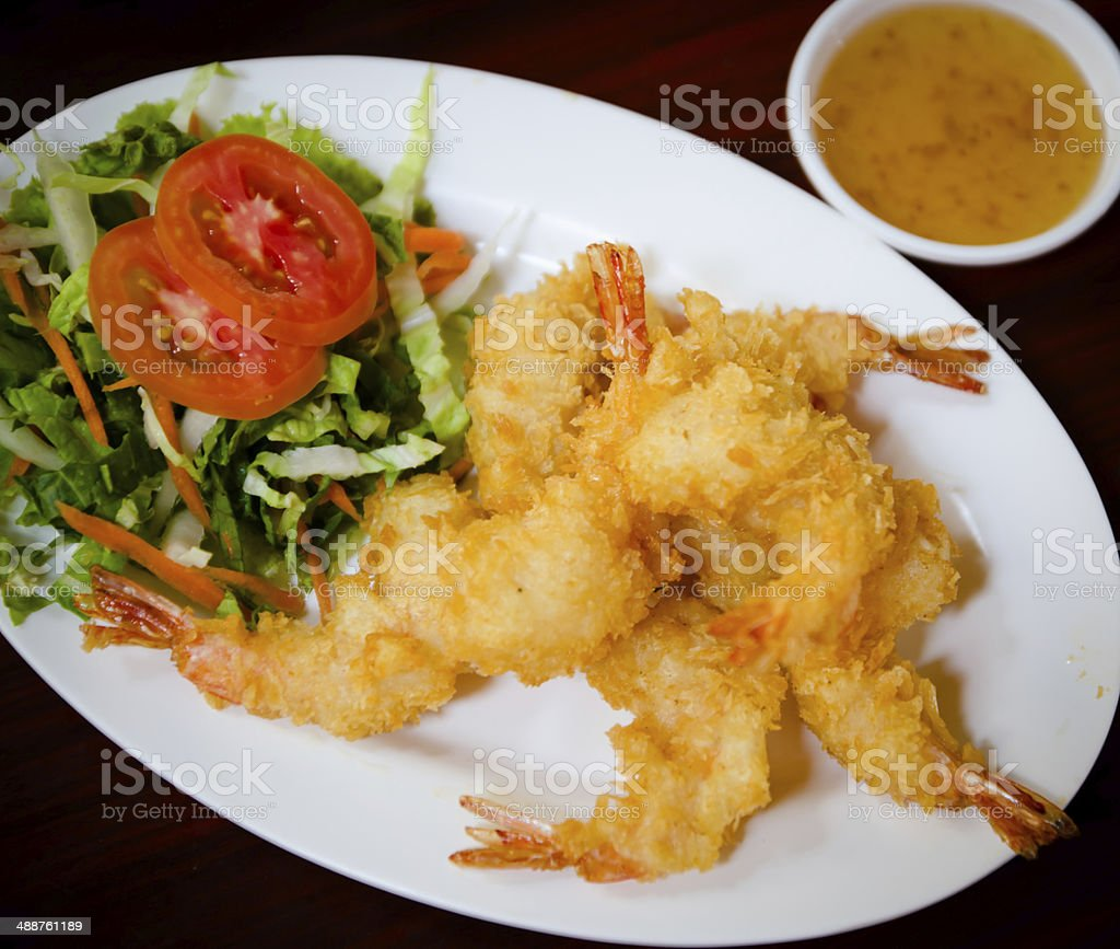 Breaded Butterfly Prawns - Deep fried battered prawns stock photo