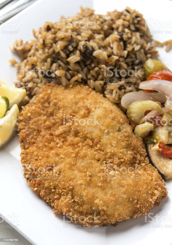 Breaded Chicken Breast (or Fish) Milanese royalty-free stock photo