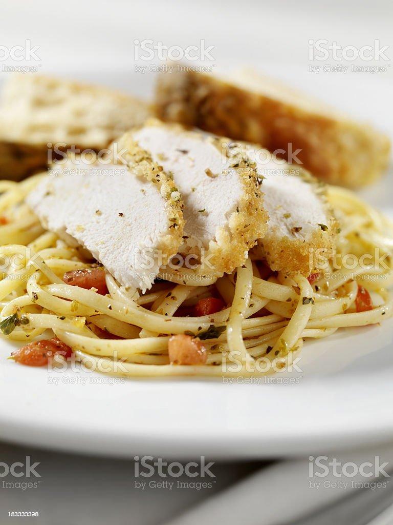 Breaded Chicken Breast with Tomato Linguini stock photo