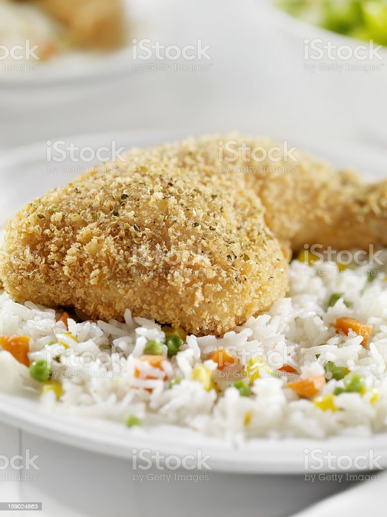 Breaded Chicken Leg with Rice and Vegetables stock photo