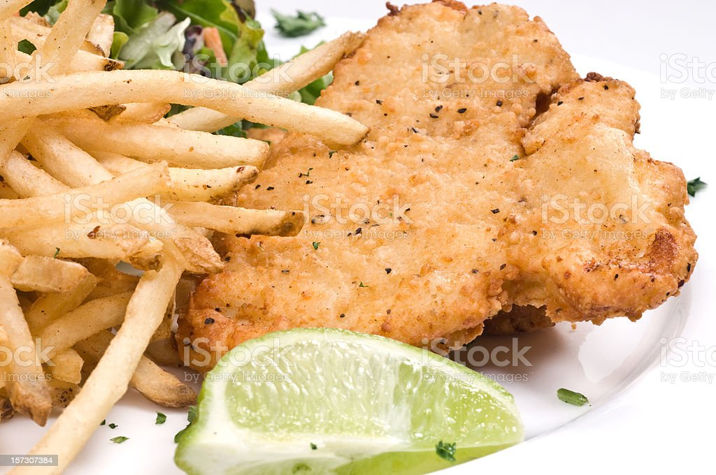 Breaded chicken, salad, and fries stock photo