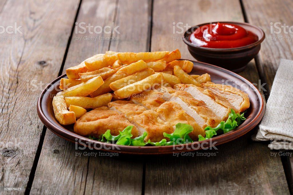 breaded chicken schnitzel with potatoes stock photo