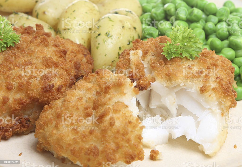 Breaded Cod Fillet and New Potatoes stock photo