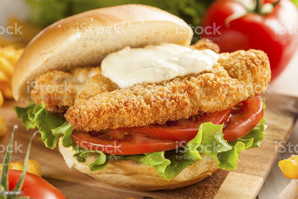 Breaded Fish Sandwich with Tartar Sauce stock photo