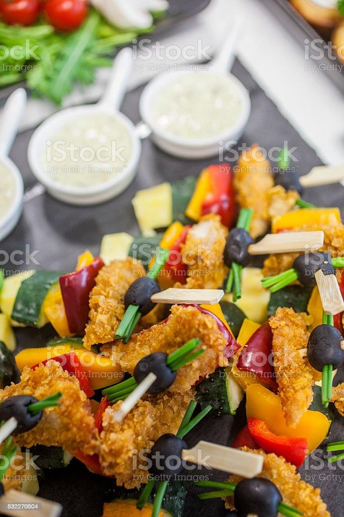 Breaded fish with olives stock photo