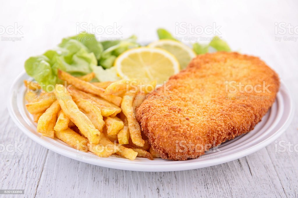 breaded meat and fries stock photo