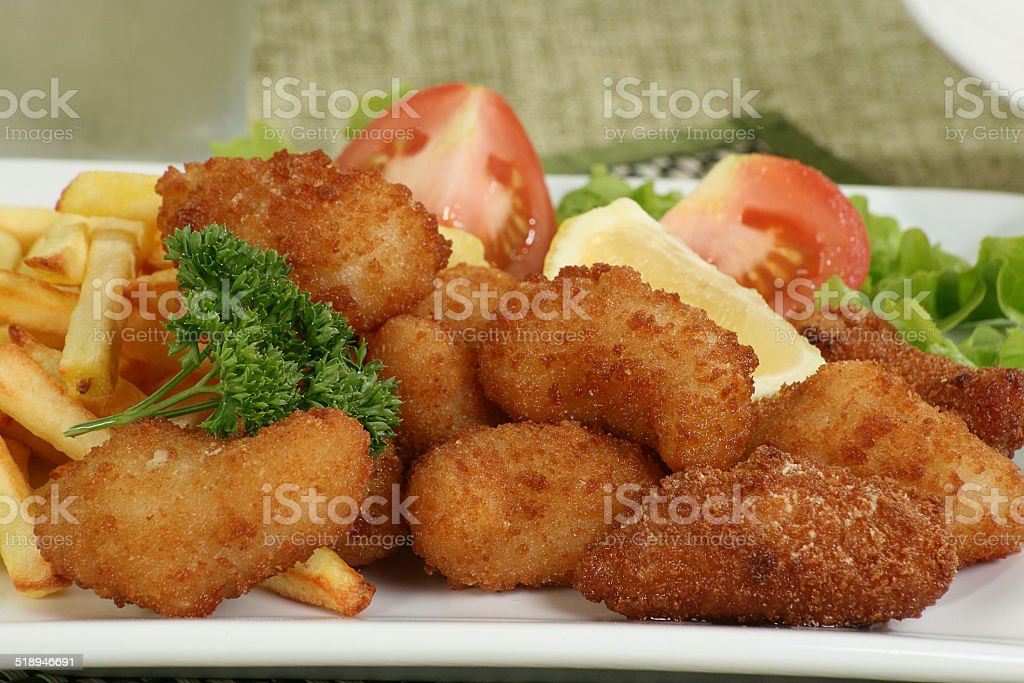 breaded scampi and chips stock photo