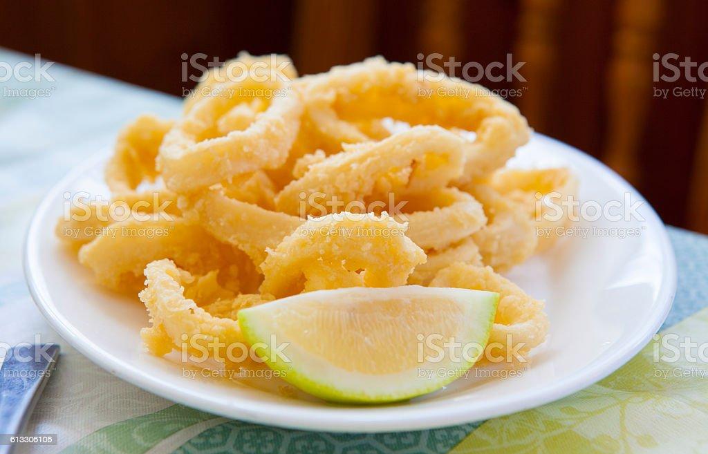 Breading fried squid -  calamares a la romana stock photo