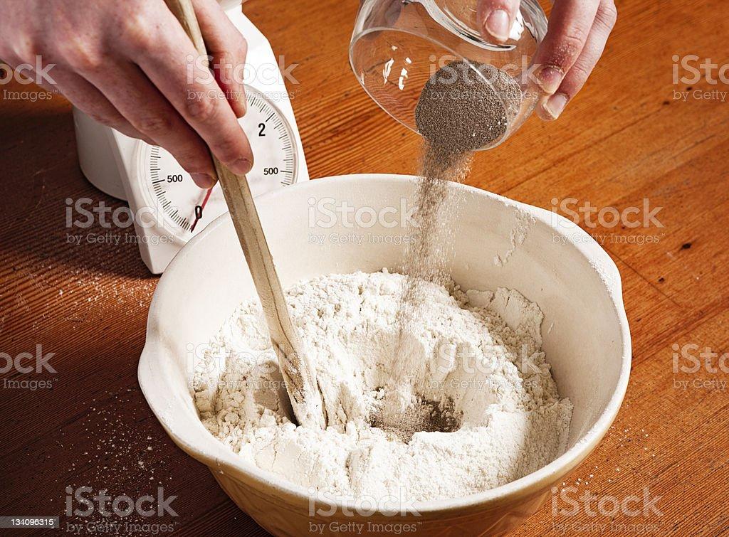 Breadmaking: Adding the yeast stock photo