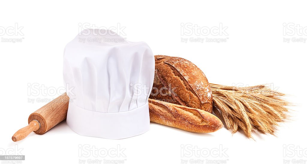 Breads, chef's hat and wheat panorama royalty-free stock photo