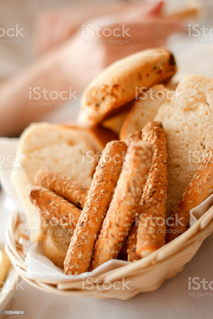 Breadsticks and Dinner Rolls on Dining Table royalty-free stock photo