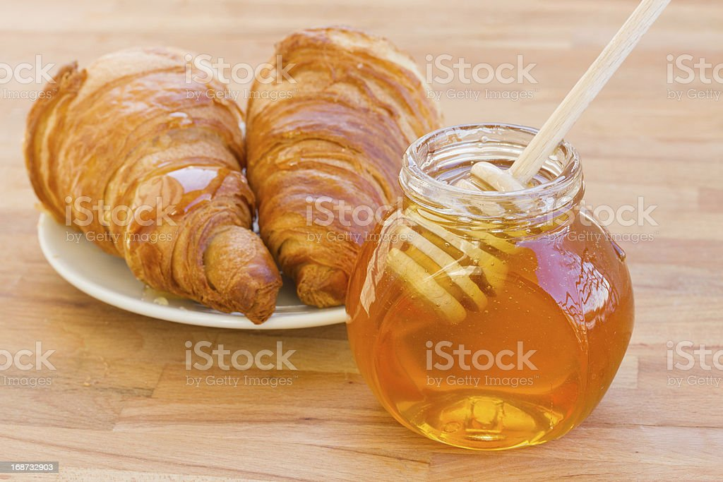 breafast with croissants and honey royalty-free stock photo