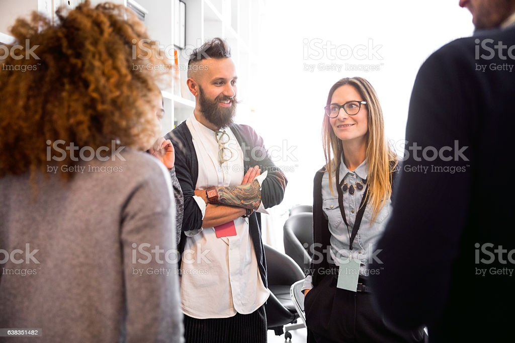 Break and chat with co-workers in the office stock photo