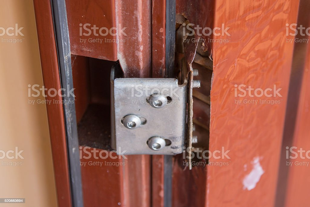 Break away mounting loops on the cheap metal doors stock photo