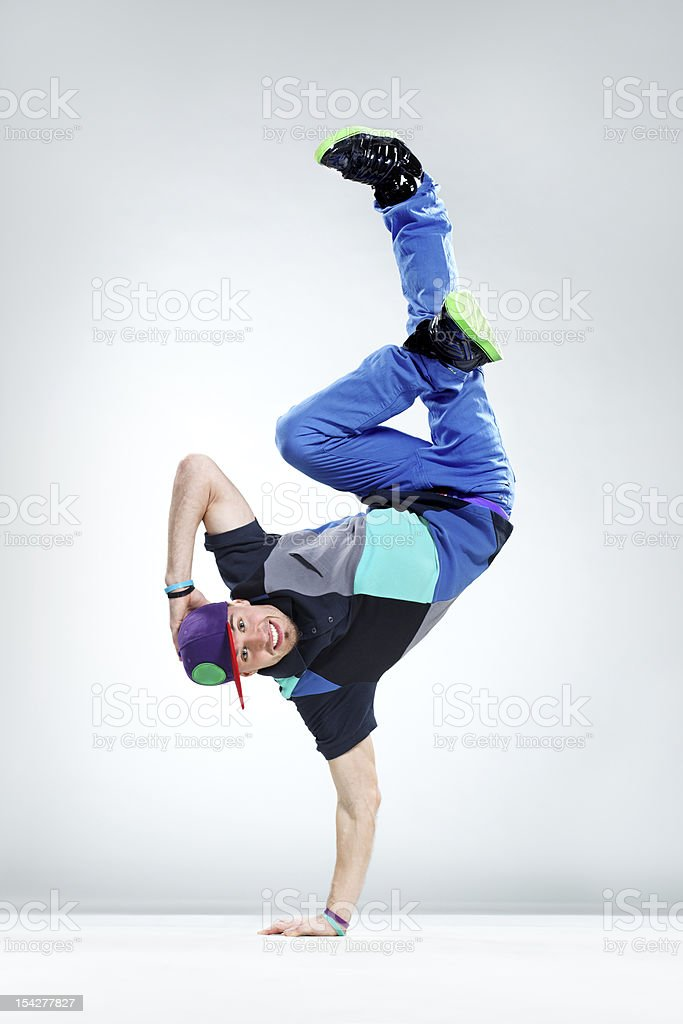 Break dancer doing cool handstand trick royalty-free stock photo