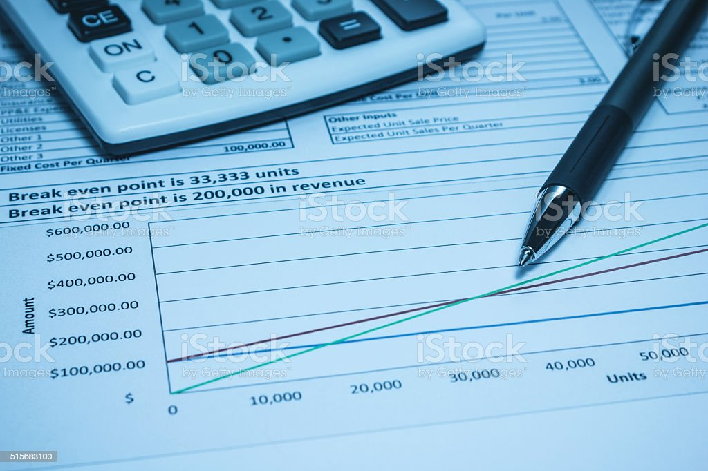 Break even inevstment spreadsheet analysis calculator and pen stock photo