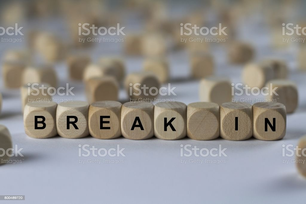 break in - cube with letters, sign with wooden cubes stock photo