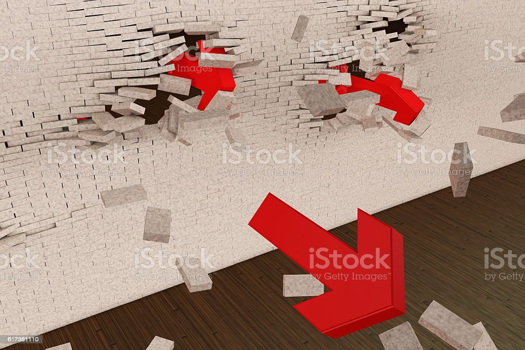 Break through the brick wall with the red arrows stock photo