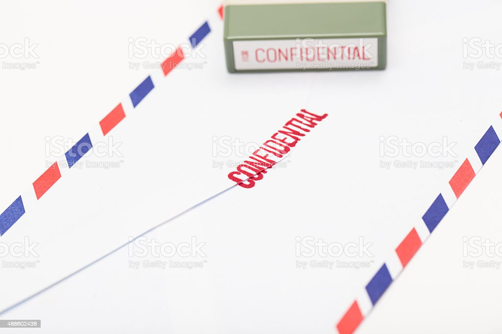 Break through the Confidential Letter stock photo