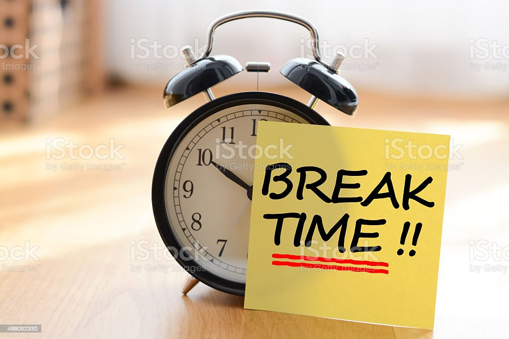 Break time concept with classic alarm clock stock photo