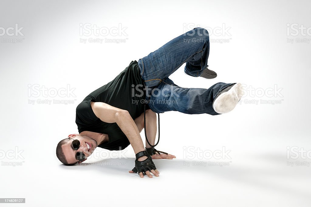 breakdancer performing head and handstand royalty-free stock photo