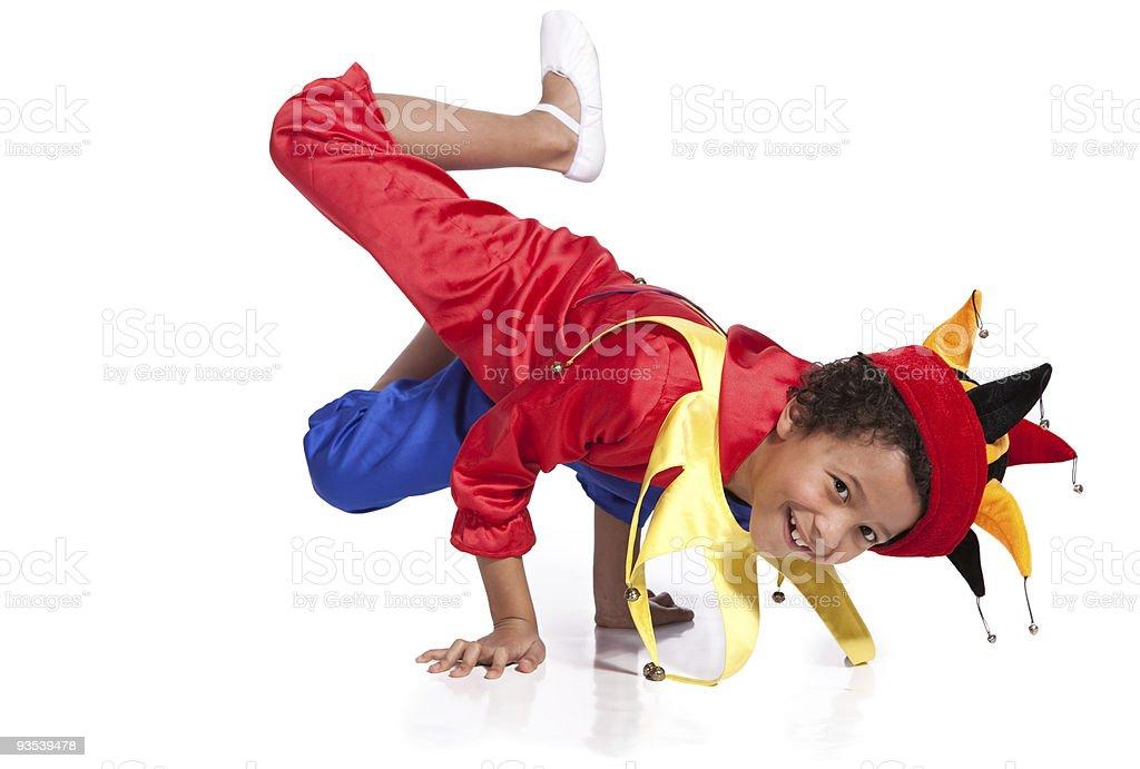 Breakdancing boy dressed in clown costume stock photo