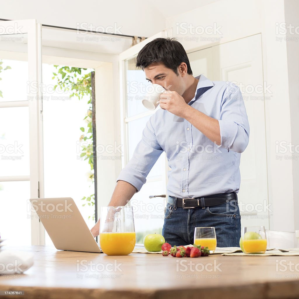 Breakfast and working stock photo