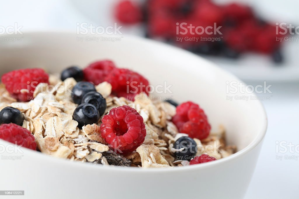 Breakfast bowl full of granola and mixed berries stock photo