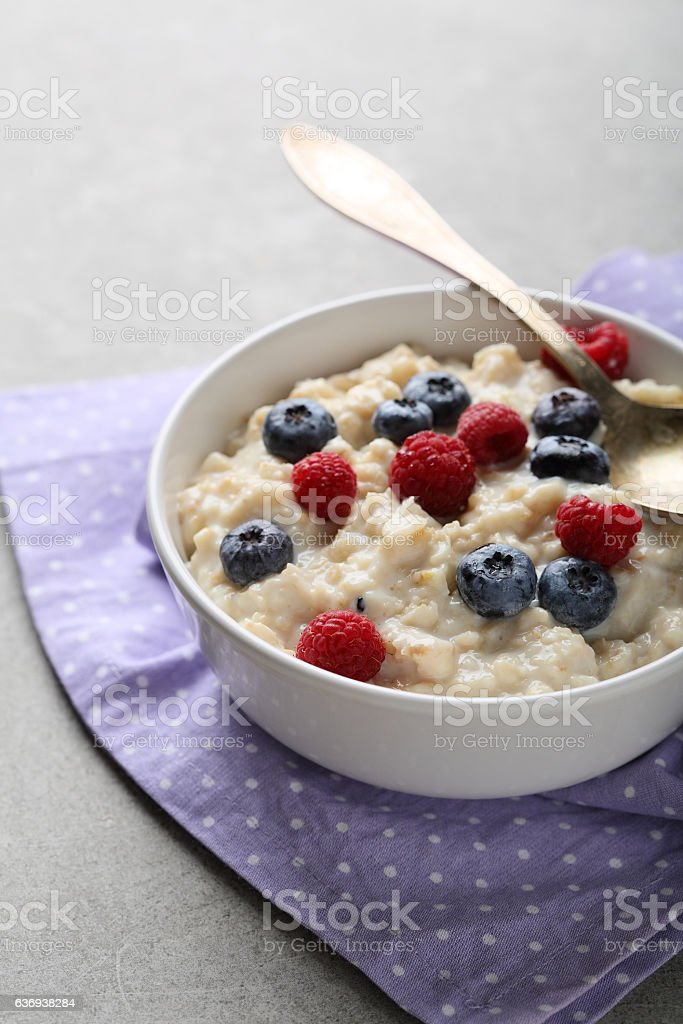 Breakfast bowl with raspberry stock photo