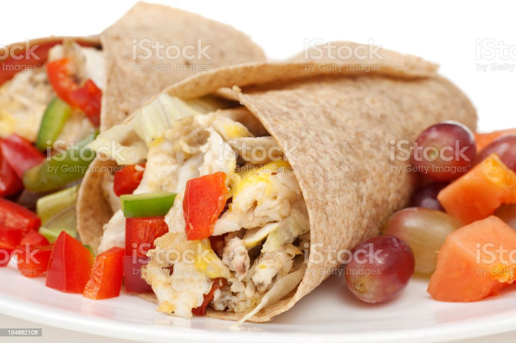 Breakfast Burrito with Eggs, Potatoes; Onions, Peppers, Grapes a stock photo