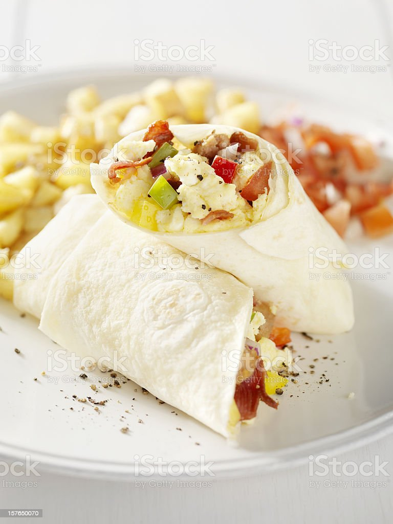 Breakfast Burrito with Hash Brown Potatoes and Salsa stock photo
