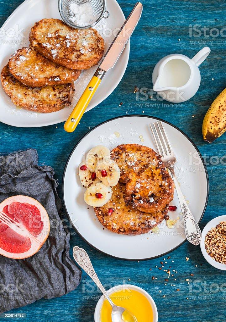 Breakfast - caramel cinnamon french toast with a banana. stock photo