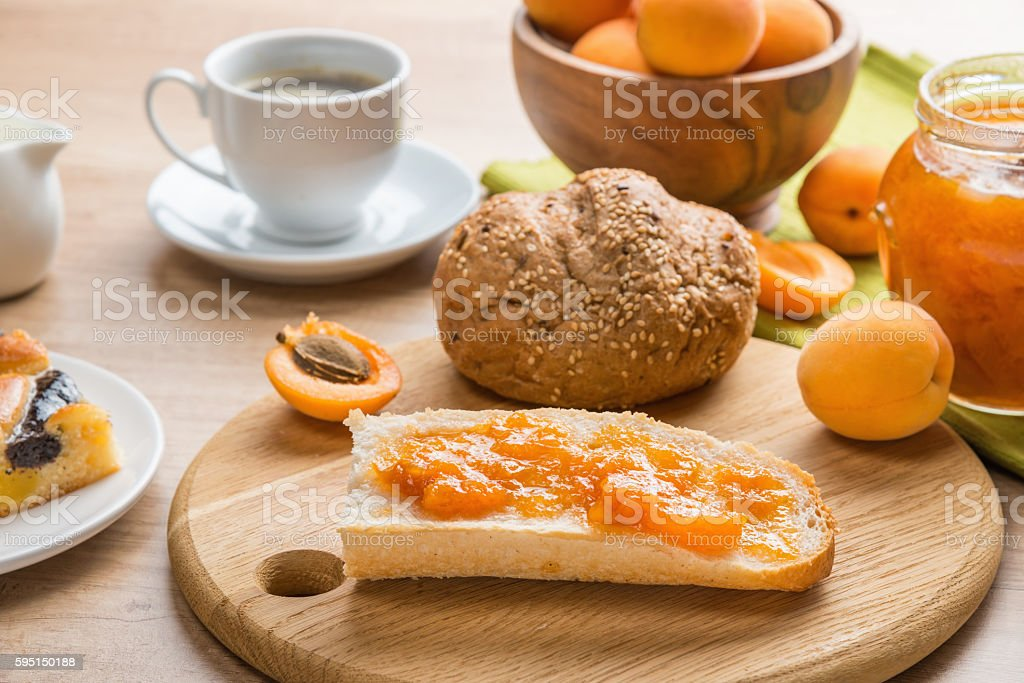 Breakfast: coffee, pastries, apricots a nd jam stock photo