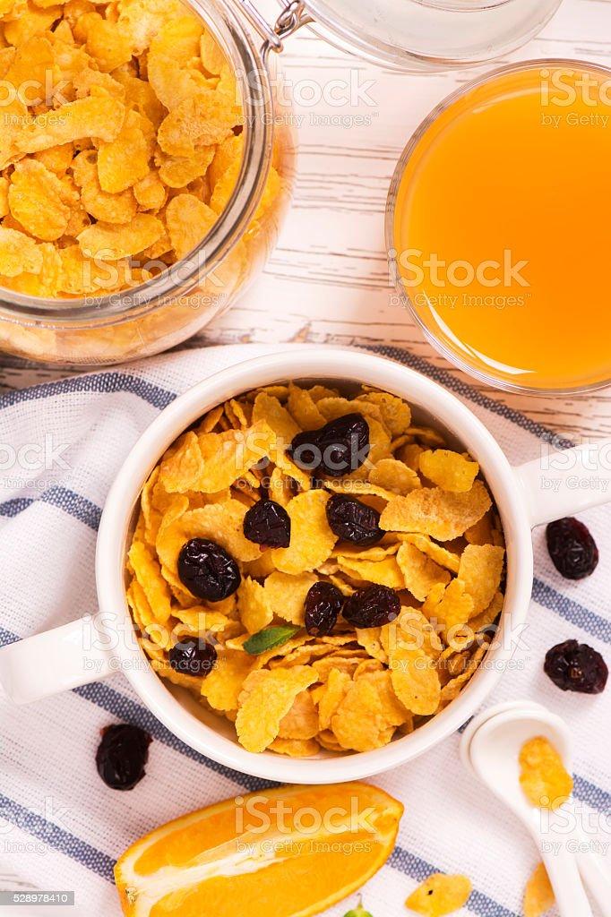Breakfast concept with corn flakes, milk and orange juice stock photo