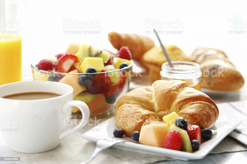 breakfast- croissant, fruit salad and coffee stock photo