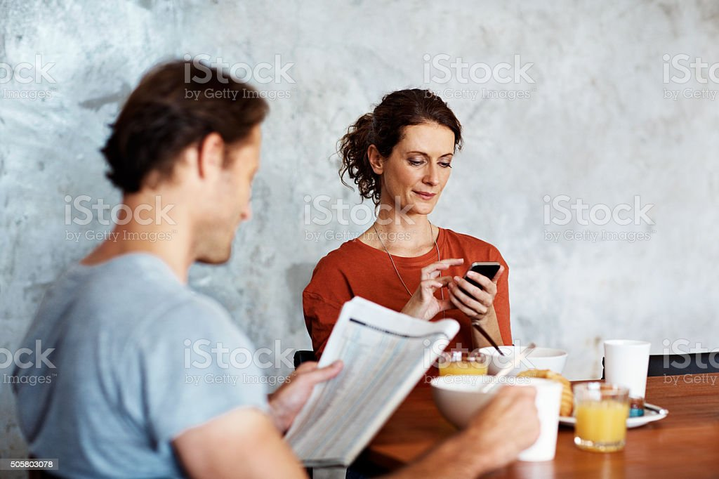 Breakfast distractions stock photo