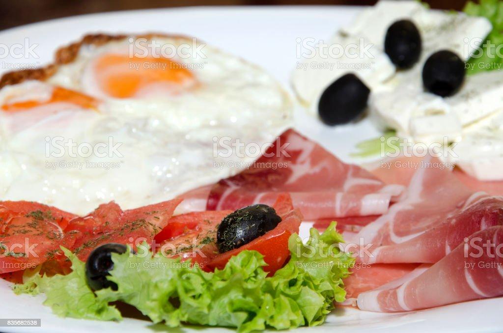 Breakfast eggs and Prosciutto stock photo