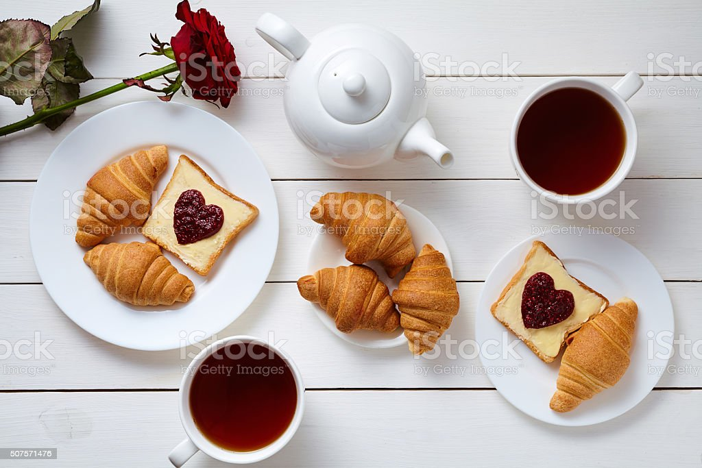 Breakfast for couple on Valentines Day with toasts, heart shaped stock photo