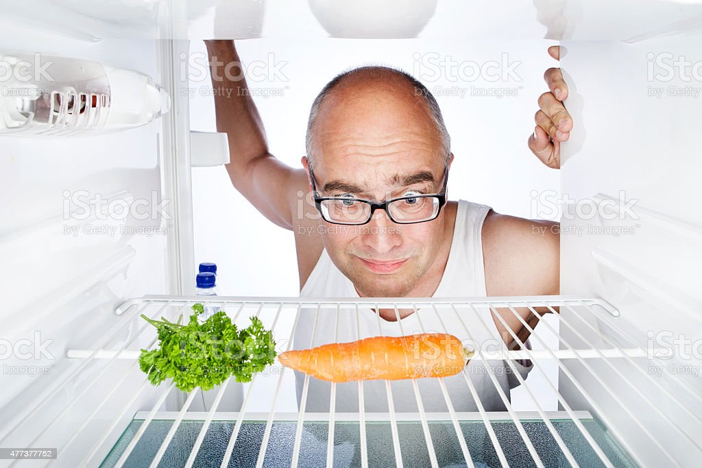 Breakfast fridge empty disappointed middle-aged man stock photo