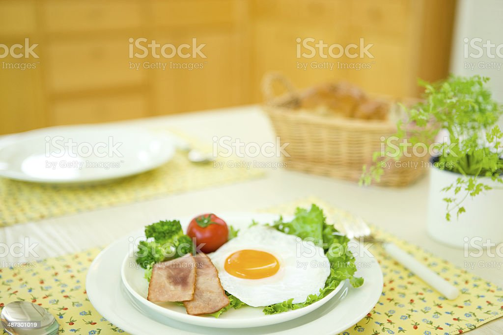 Breakfast, fried egg and chervil, on a table royalty-free stock photo