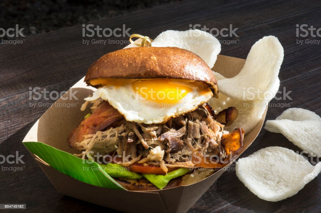Breakfast Fried Egg And Pulled Pork Bagel Sandwich stock photo