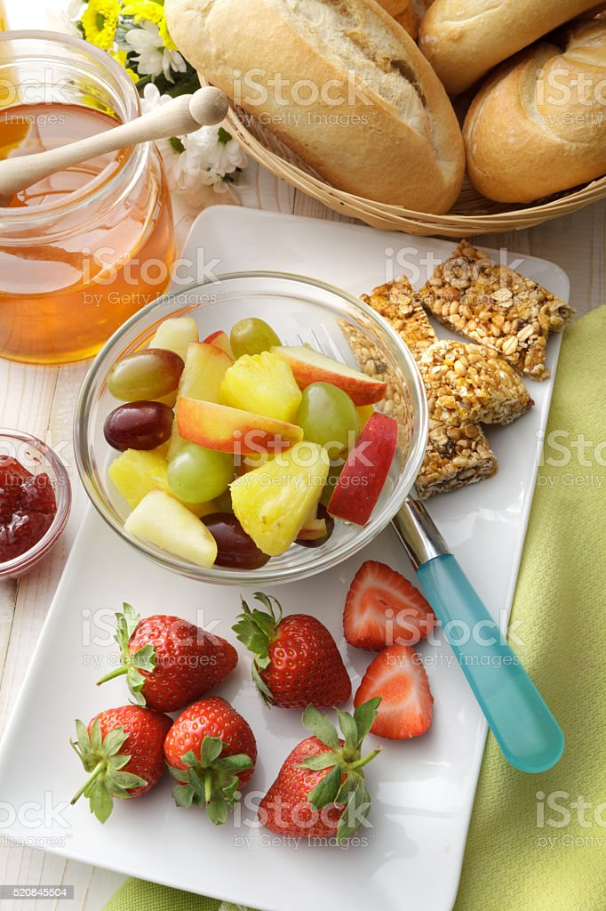 Breakfast: Fruit Salad, Bread Buns, Orange Juice and Honey stock photo