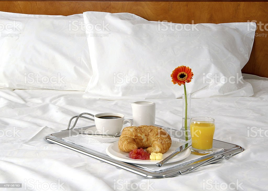 Breakfast in bed at hotel room. stock photo